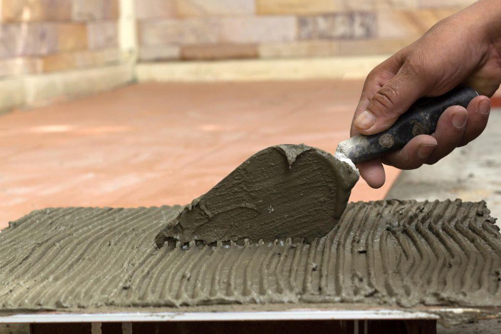 a man putting cement
