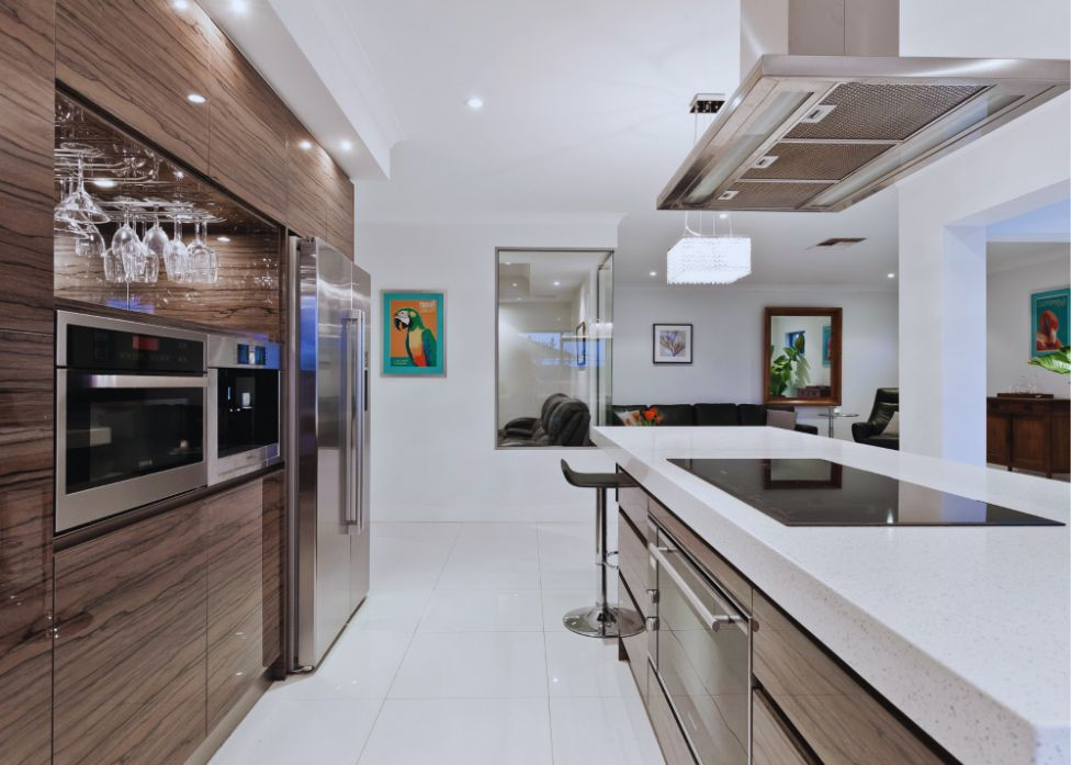 On this picture you see a white and baggie kitchen colors. The kitchen was remodel by our kitchen tile installers Miami team in May 2021. The client just purchased and older house and wanted to remodel his kitchen in a modern style. The colors were carefully chosen by our designer and approved by the client.
