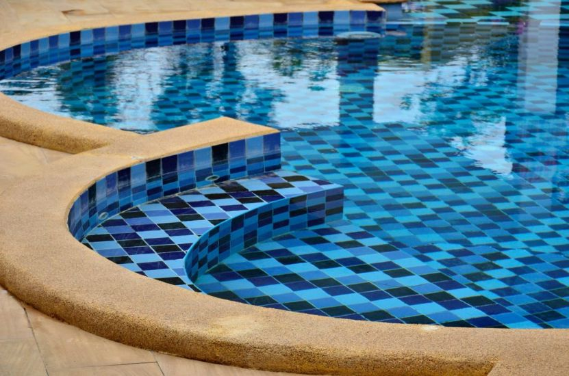 On this image you see a tile installed in the pool. This project was done by our pool tile installers Miami team in three days as requested by the client. The beautiful colors of pool tile make the pool look larger than it actually is. The image was taken in May 2021.