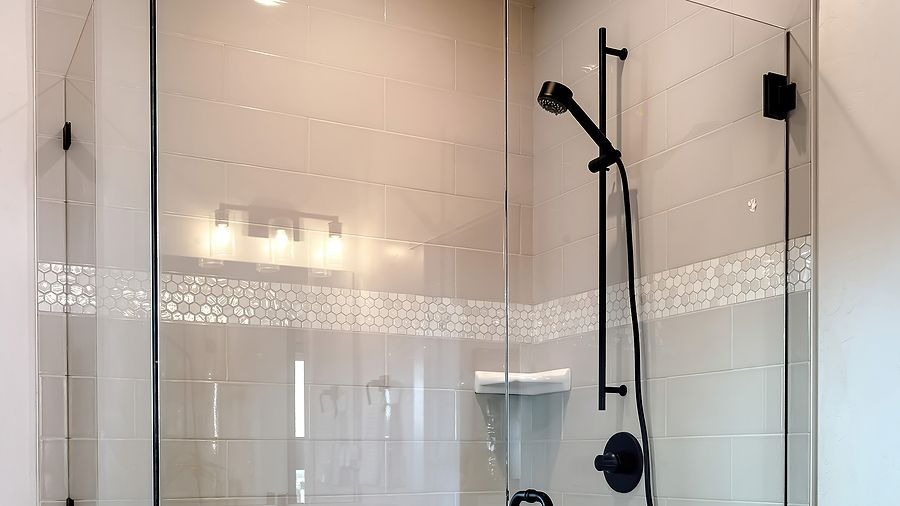 Shower tile installers Miami professional crew specializes only on shower tile installation. On this image you see a shower tile which was installed in two days. The colors of white and gray perfectly match the cabinet vanity. The image was taken in March of 2021